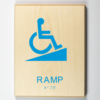 "Eco-friendly ADA braille wood sign using 3D printing that says ""Ramp"""