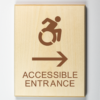 """Eco-friendly wood sign using 3D printing that says """"Accessible entrance to the right"""""""