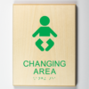 ADA compliant wooden sign showing baby diaper changing area