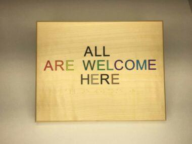 All are welcome here sign in wood
