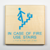 "Eco-friendly ADA braille wood sign using 3D printing that says ""In case of fire use stairs"