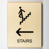 Wooden directional sign showing stairs to the left