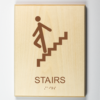 ADA compliant wooden sign showing stairs
