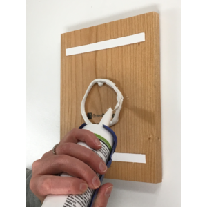 ADA sign mounting with tape and silicone