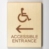 "Eco-friendly wood sign using 3D printing that says ""Accessible entrance to the left"""