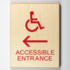 Wooden Sign showing handicap accessible entrance to left