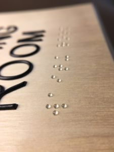 Close up of raised dots on a sign