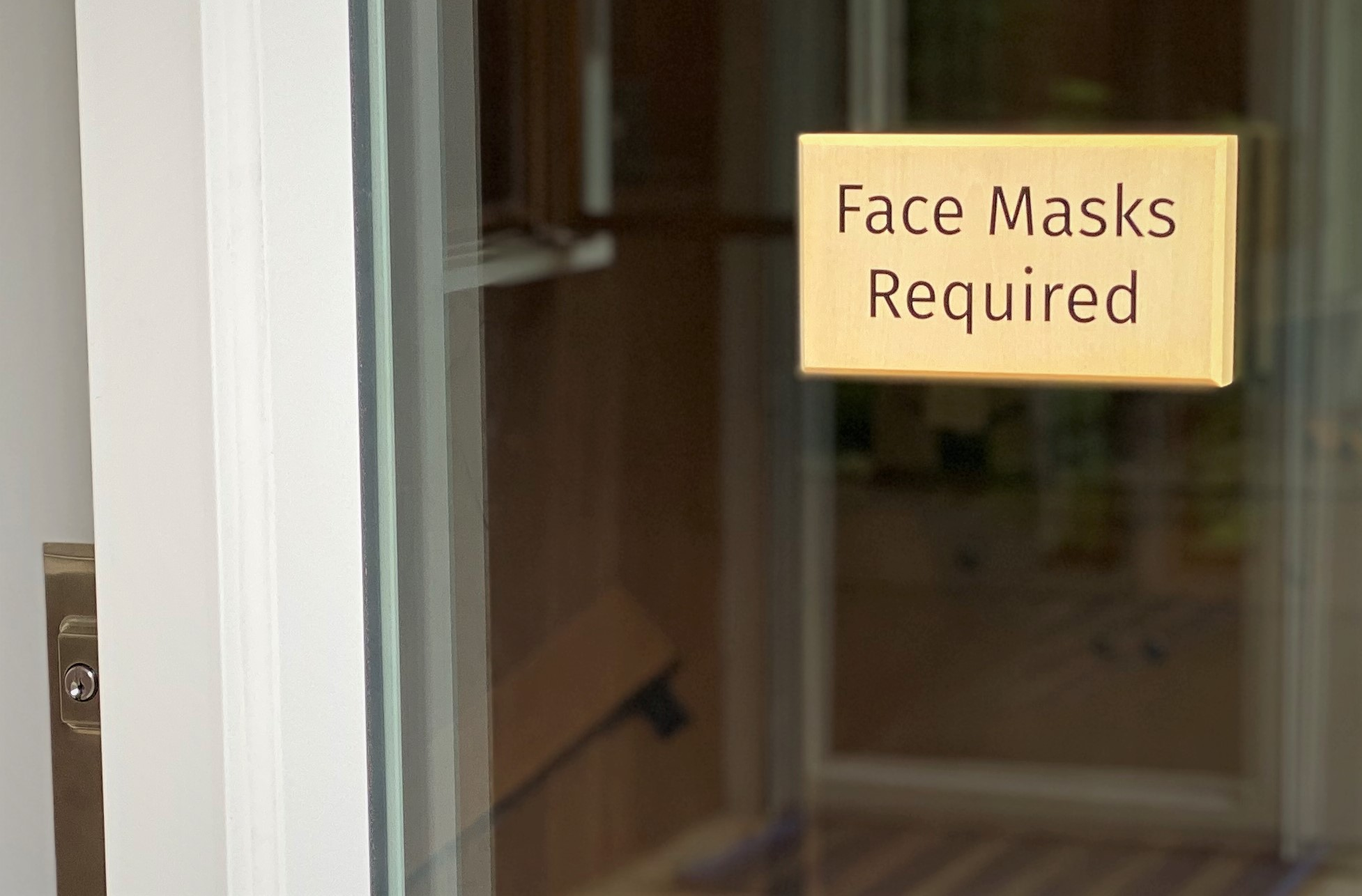 Face masks required sign on window