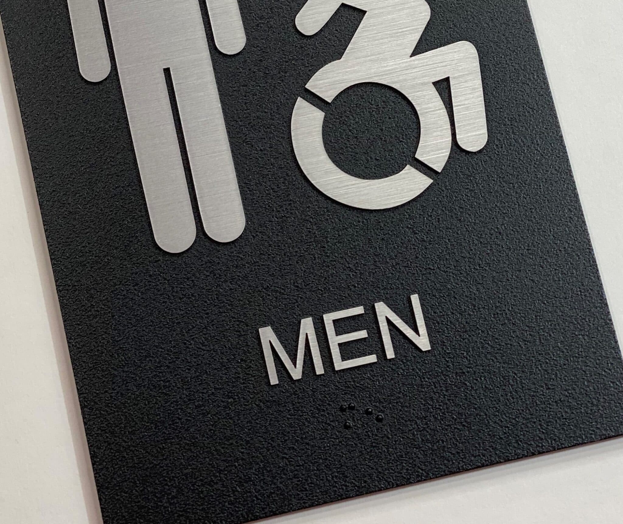 Exterior Mens Restroom Sign, braille close up