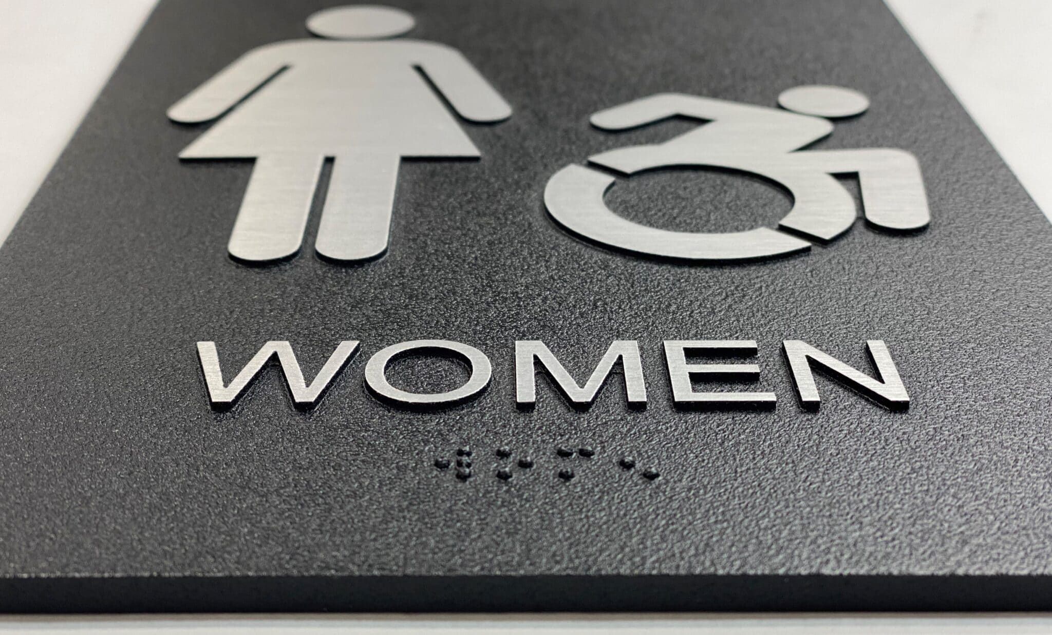 Exterior Womens Restroom Sign, braille close up