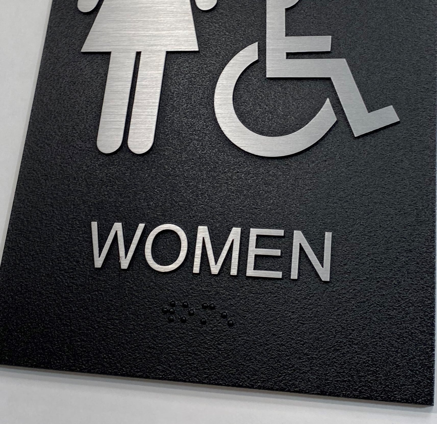 Exterior ADA Womens Restroom Sign Braille Close Up